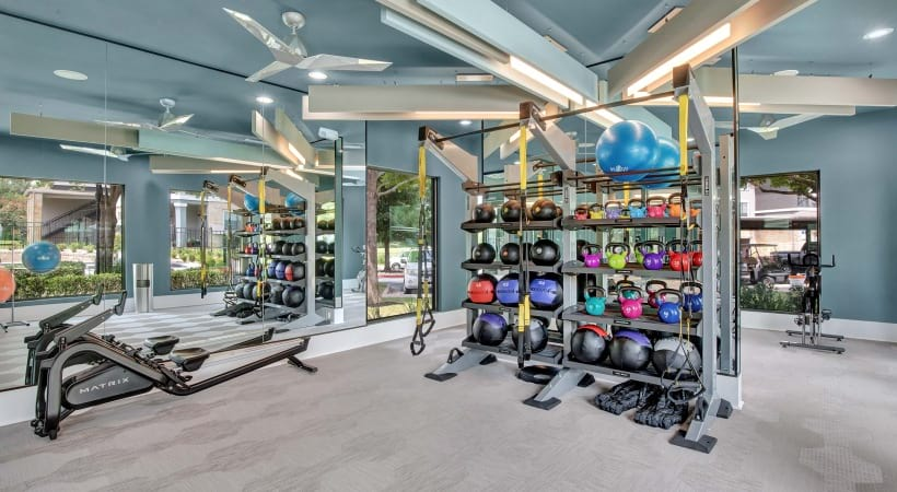 Fitness center with free weights at Cortland Southpark Estates