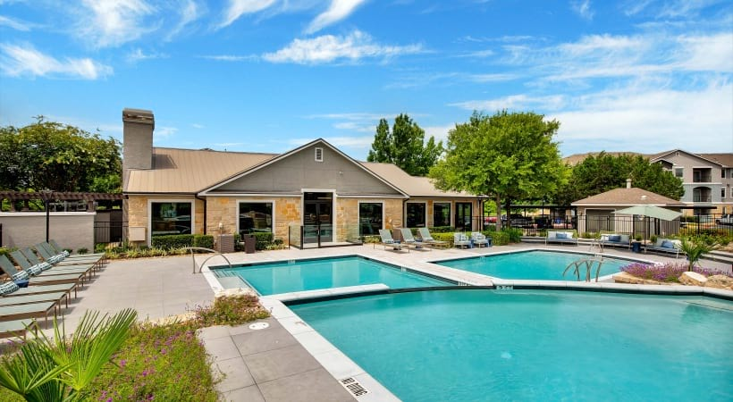 Resort-style pool and sun deck at Cortland Southpark Estates