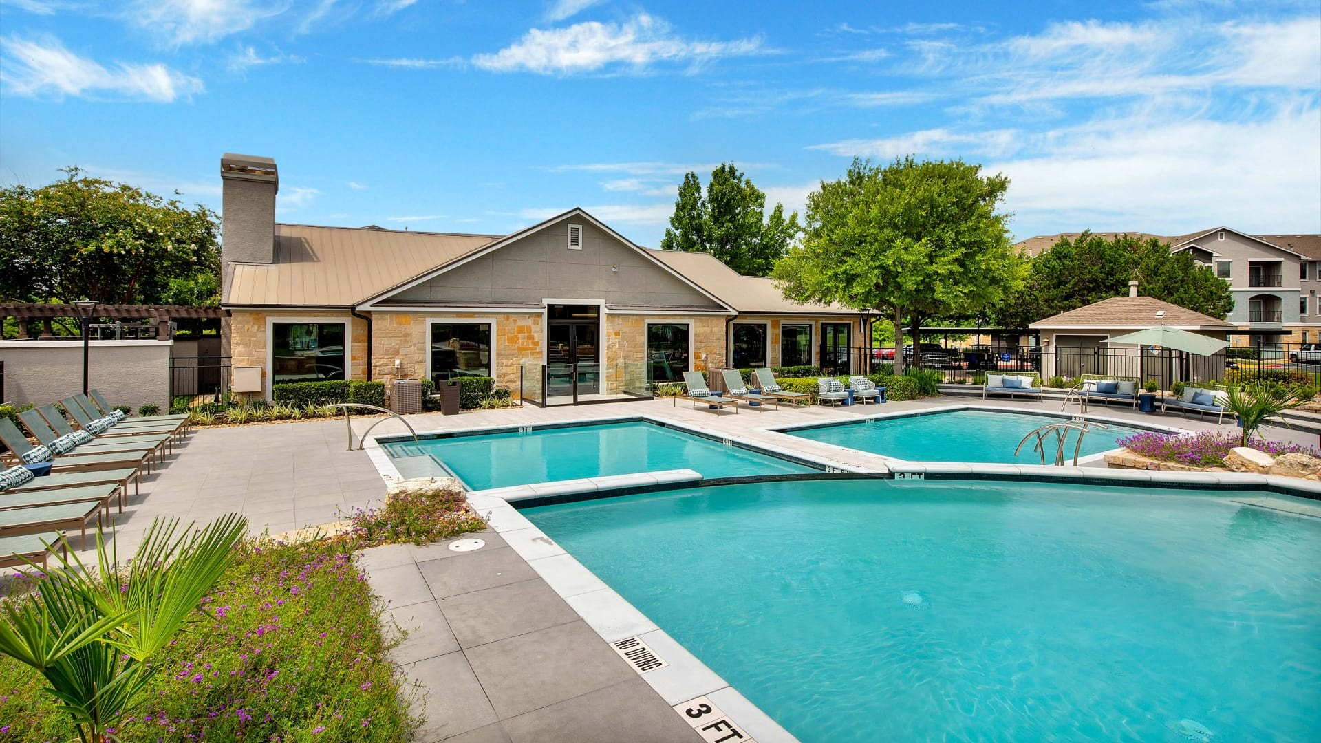 Two apartment pools at Cortland Southpark Estates
