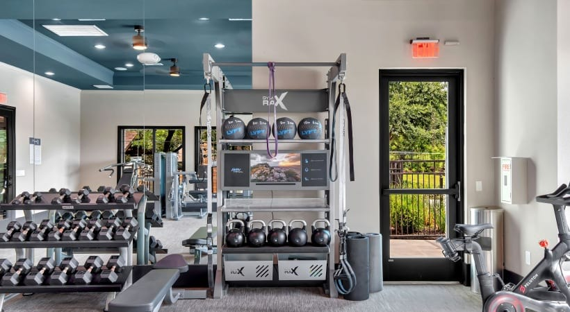 Free weights at Cortland Southpark Terraces fitness center