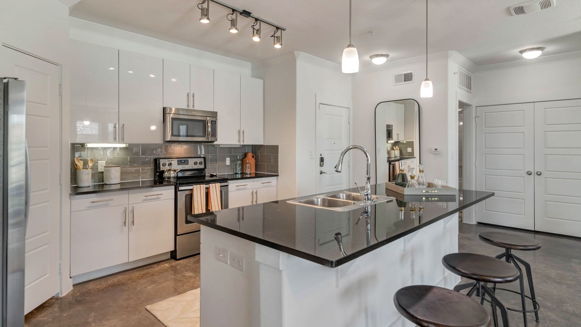 Spacious apartment kitchen with granite countertops