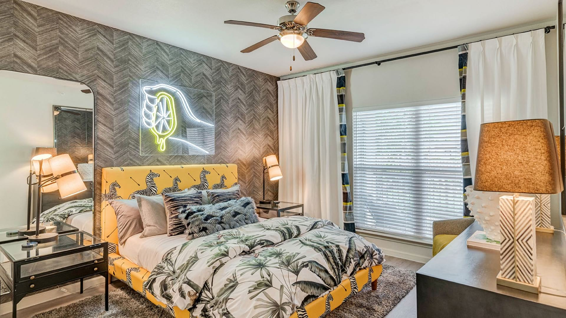 Bedroom with wide windows at our Onion Creek apartments in Austin, TX