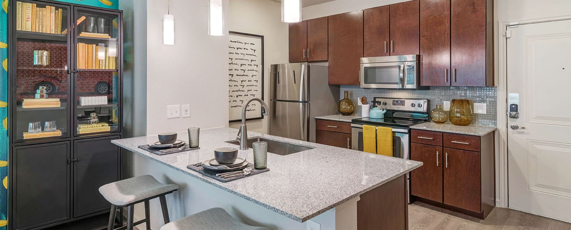 Kitchen with modern cabinetry at our upscale apartments in South Austin, TX