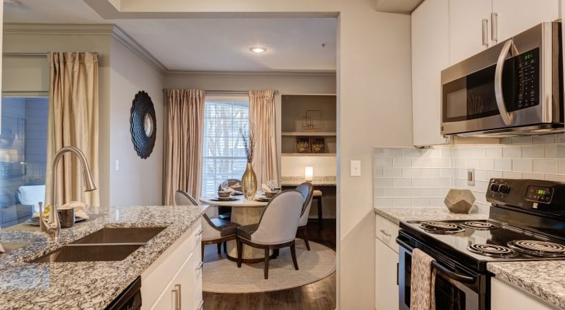 Kitchen and dining area in a Cortland at RTP apartment