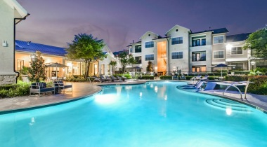 Resort-style pool with night lights at our luxury apartments for rent in South Austin