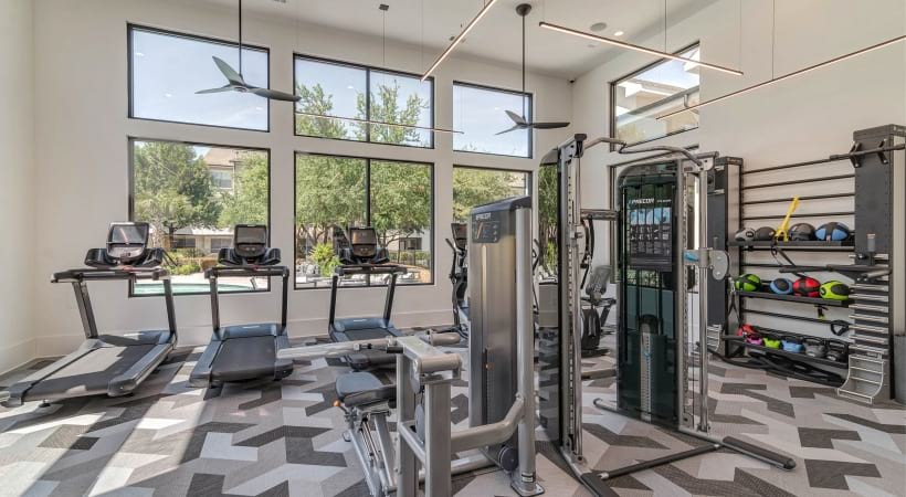 Our South Austin apartment gym with treadmills and weights