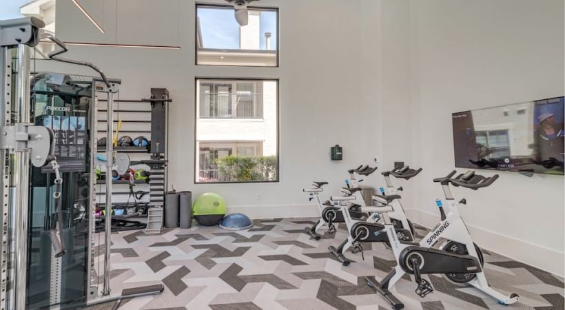 Our South Austin apartment gym with bike stations and weights