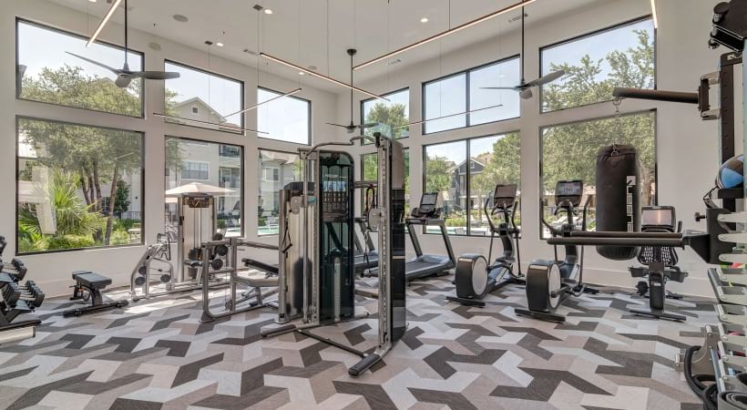 Our South Austin apartment gym with floor to ceiling windows