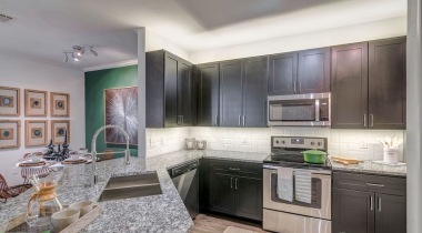 Kitchen with stainless steel appliances at our luxury apartments in Bluff Springs