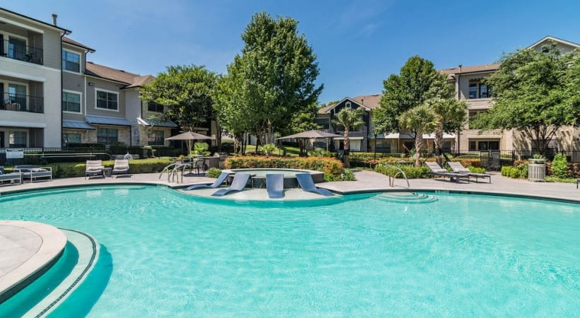 Resort-style pool with sun deck at our luxury apartments in Bluff Springs
