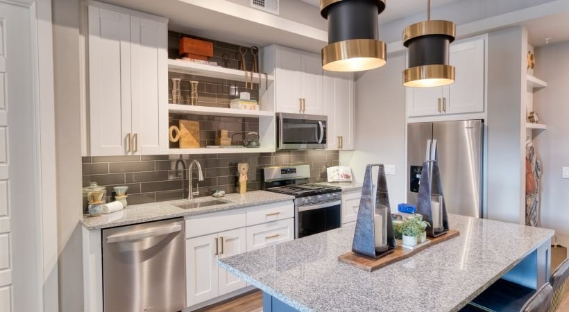 Gourmet Kitchens with Granite Countertops and Accent Tile Backsplash at Cortland Biltmore Apartments