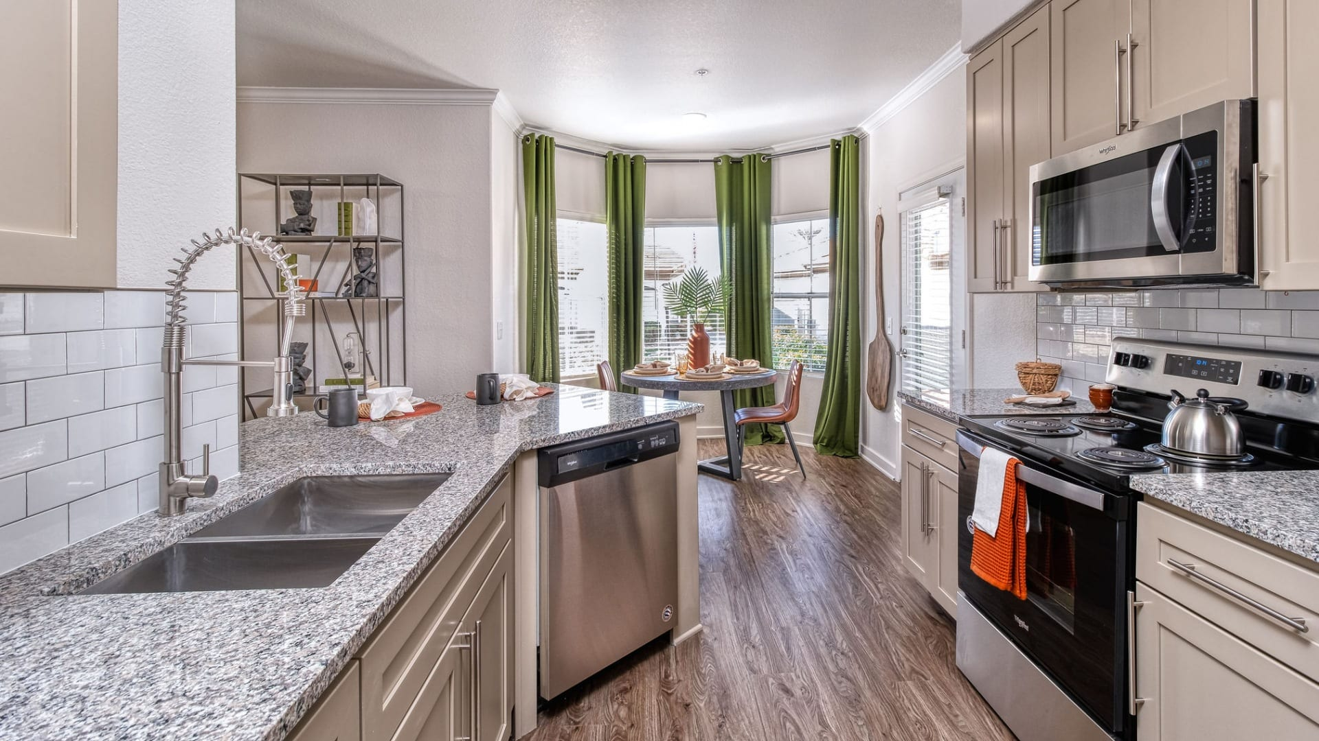 Renovated Kitchen with Wood-Style Flooring at Cortland Desert Ridge Apartments