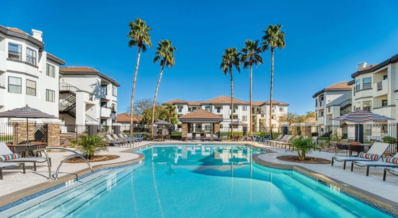 Resort-style pools with heated spa at our Red Mountain apartments