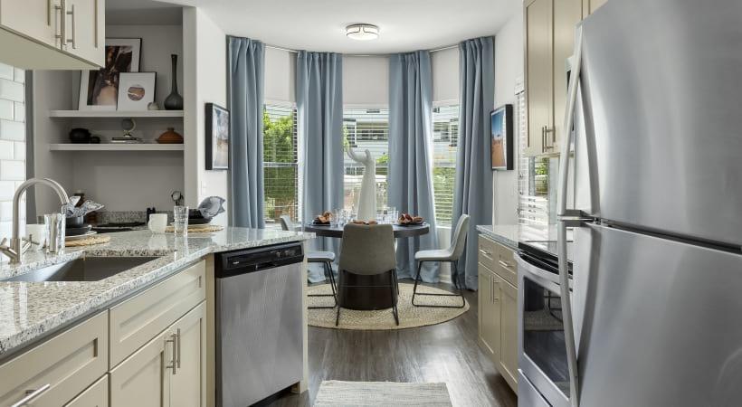 Renovated Kitchen with Granite Counters and Designer Tile Backsplash