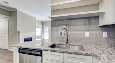 Kitchen with built-in shelves at our newly renovated apartments for rent in Cherry Creek