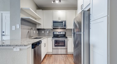 Kitchen with built-in shelving at our newly renovated apartments near Cherry Creek