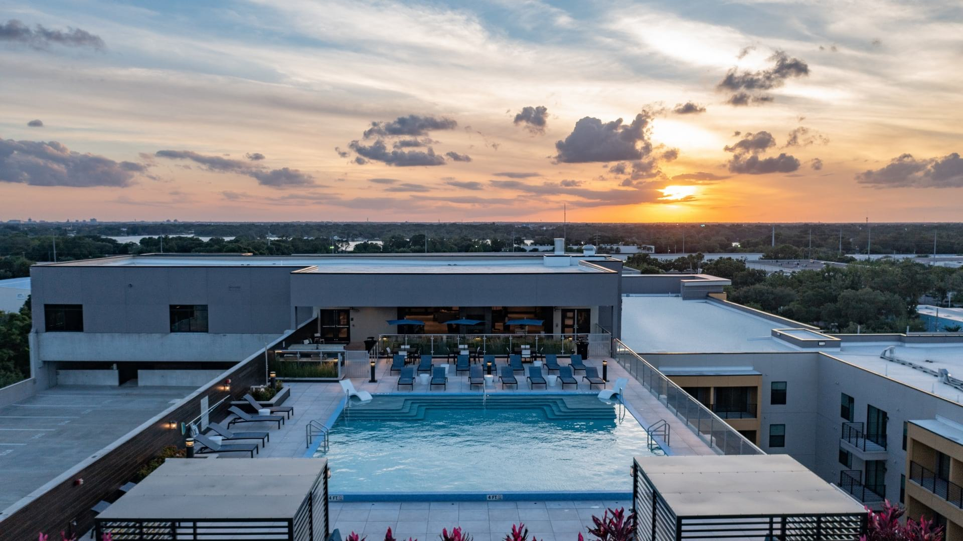 Rooftop pool at sunset at Cortland on Orange Apartments near Downtown Orlando