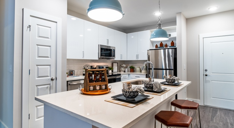 Kitchen Island with Quartz Countertops at Cortland at the Hill