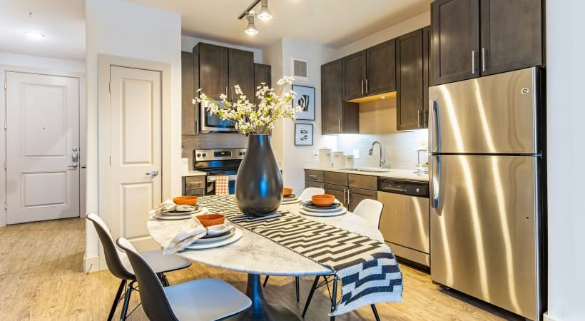 1 bedroom apartment kitchen with stainless steel appliances