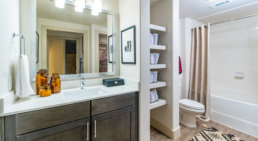 Spacious bathroom with modern lighting at Cortland at Phipps Plaza