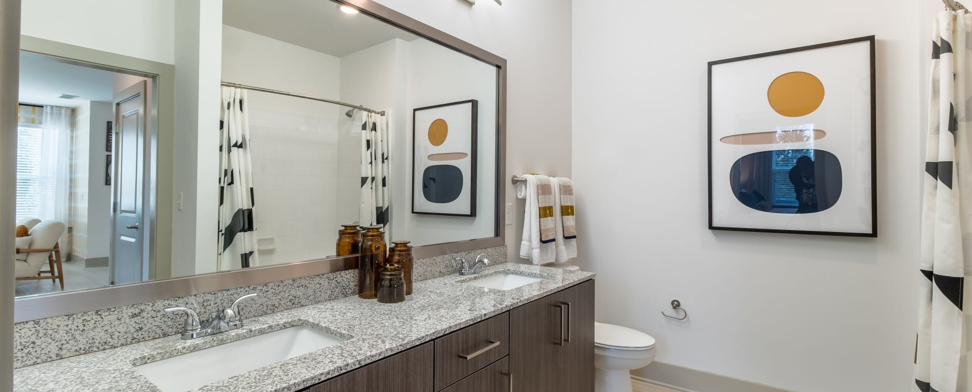 Spacious apartment bathroom with double sink vanity