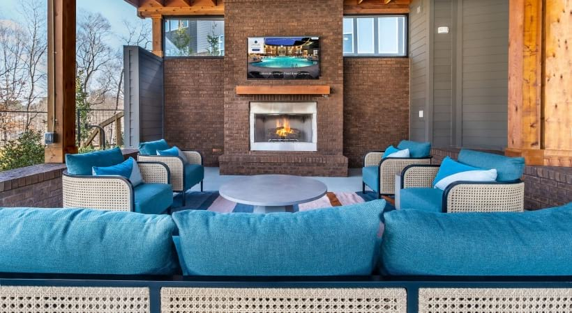 Outdoor lounge with fireplace at Cortland Peachtree Corners