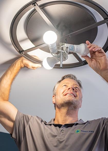 Service Tech Changing Light Bulb