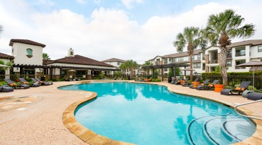 View of the apartment pool and sun deck at  our Houston apartments for rent