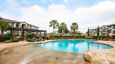 Resort-style pool and sun deck at our upscale apartments for rent in Houston, TX