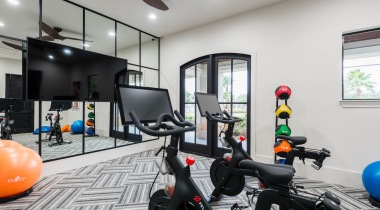 Fitness center with Peloton bikes at apartments in Willowbrook