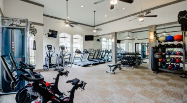 Cycling bikes, weights, and more at our Energy Corridor Houston apartment with gym