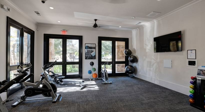 Our Preserve at Fredericksburg apartment gym with spin cycle equipment