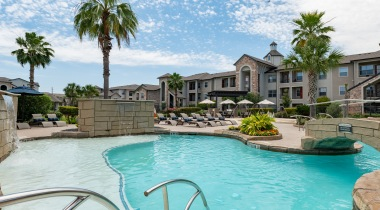 Resort-style apartment pool and outdoor sitting at Cortland Copperleaf