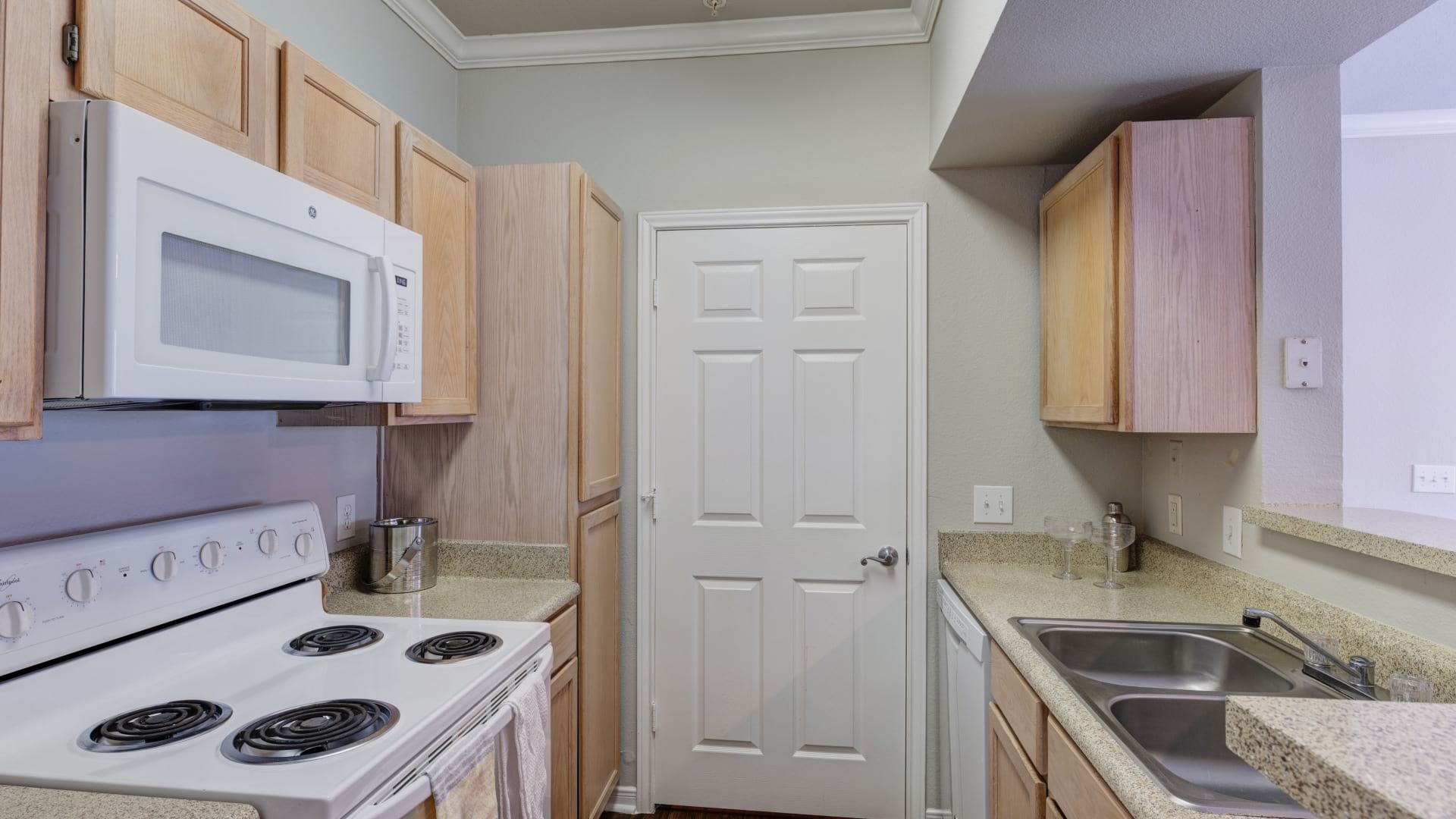 Cozy kitchen with light colored cabinets