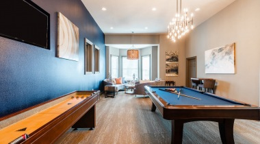 Resident clubhouse with pool table at Cortland Sugar Land