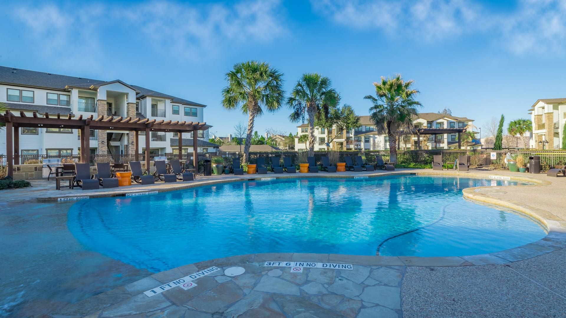 Resort-style pool and sun deck at our modern apartments in Houston, TX