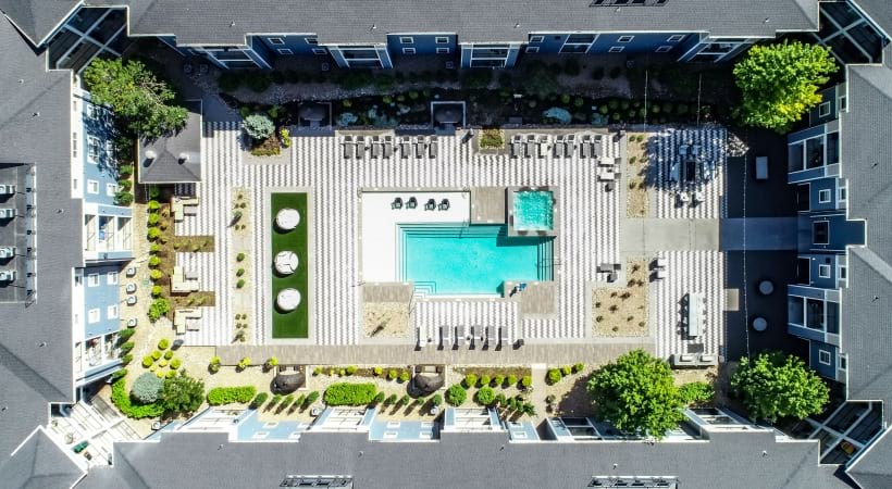 Drone shot of our resort-style pool at our upscale apartments near Denver, CO