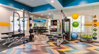 Bright open fitness center space