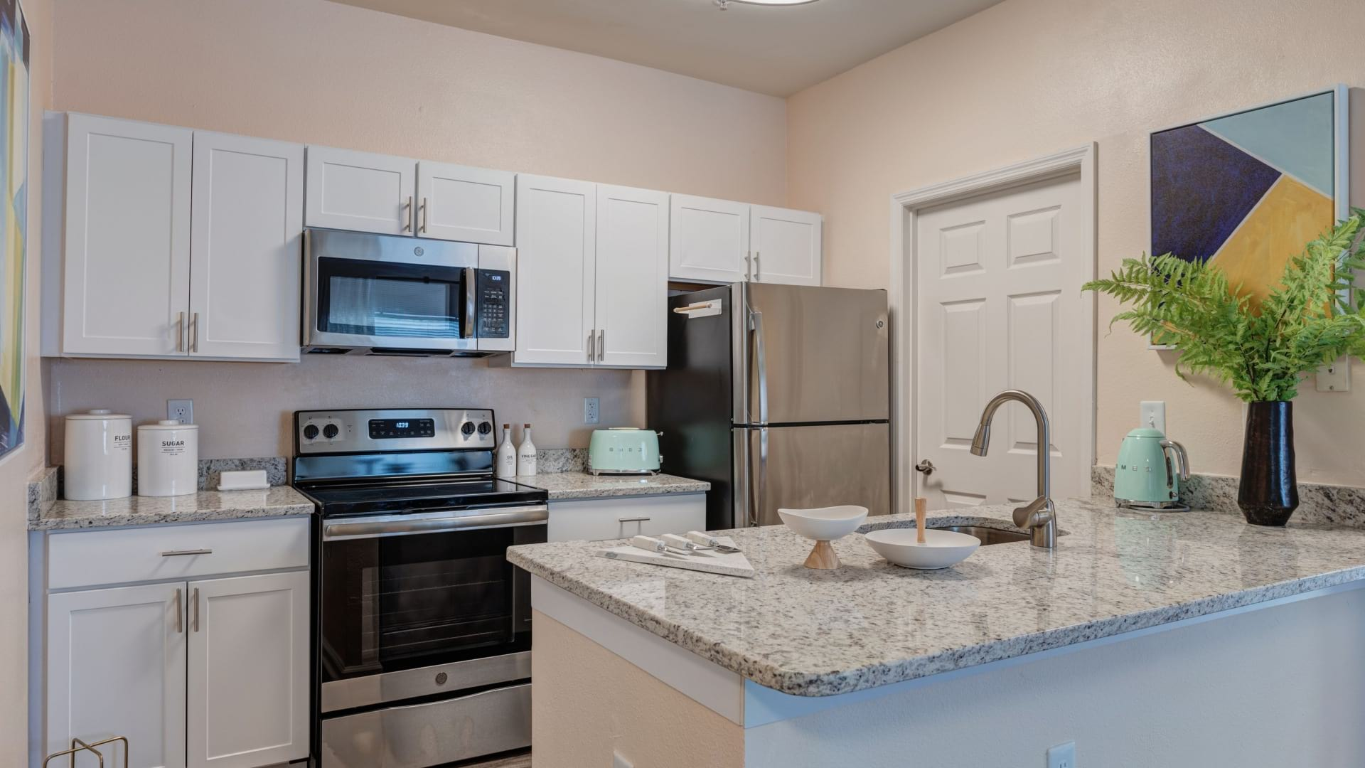 Upscale Apartment Kitchen With Granite Countertops At Our Apartments For Rent In Cary, NC