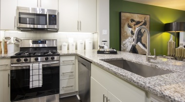 Luxury apartment kitchen with granite countertops