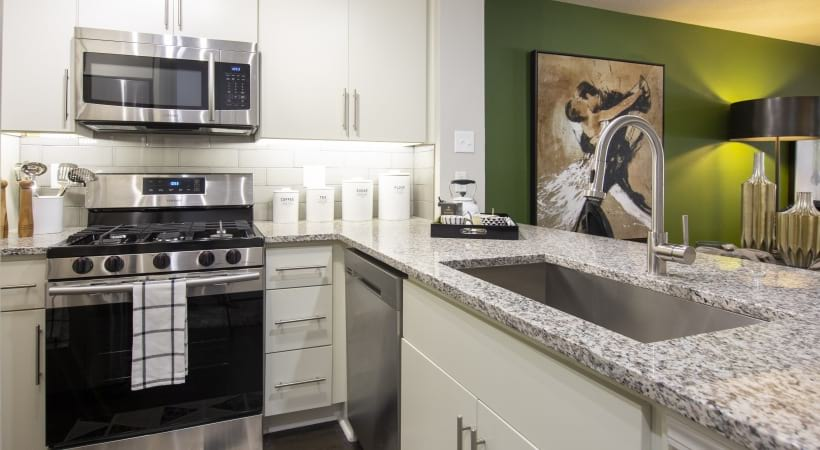 Luxury apartment kitchen with granite countertops