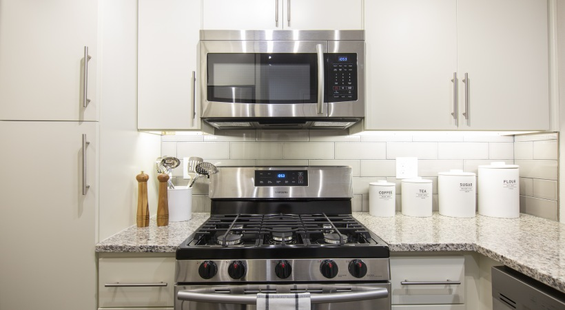 Modern two bedroom apartment kitchen with stainless steel appliances