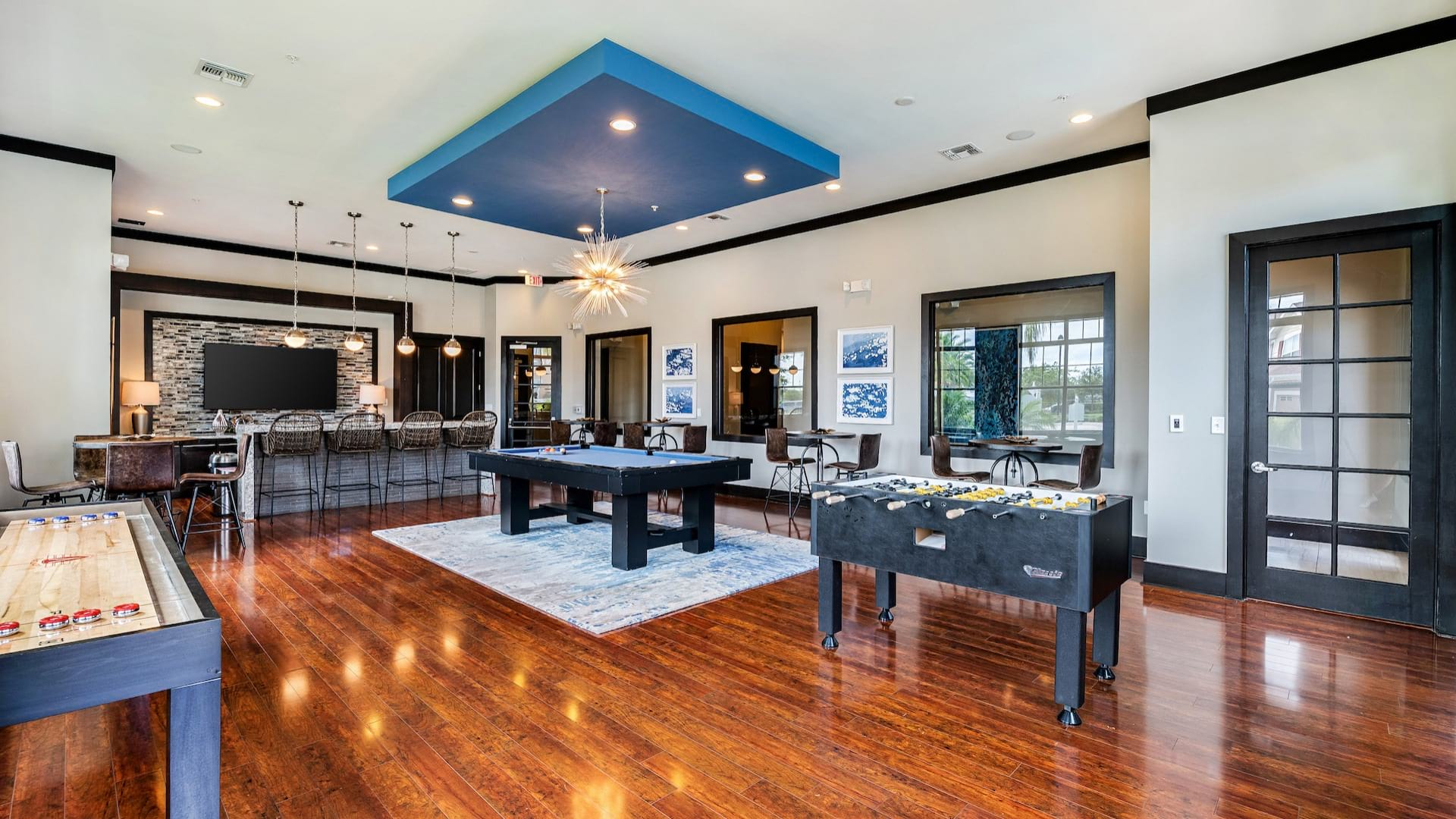 Resident clubhouse with pool table at apartments in Orlando