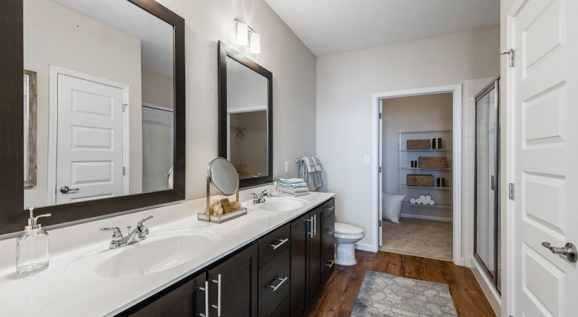 Bathroom with double sink vanities at apartments in Orlando, FL