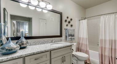 Modern apartment bathroom at Cortland La Villita