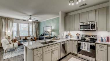 Las Colinas apartment kitchen with granite countertops