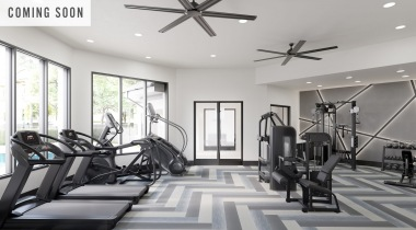 Our Allen apartment gym with ceiling fans and updated equipment