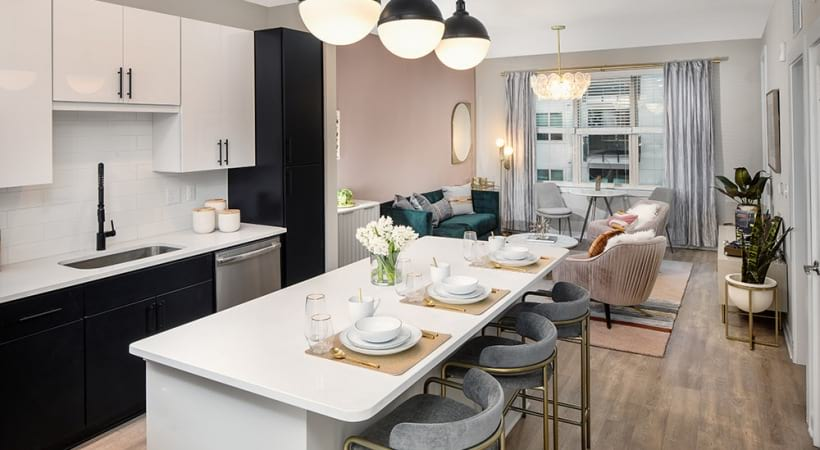 Open-Concept Kitchen And Living Space With Wood-Style Flooring At Our Apartments In Brookhaven, GA