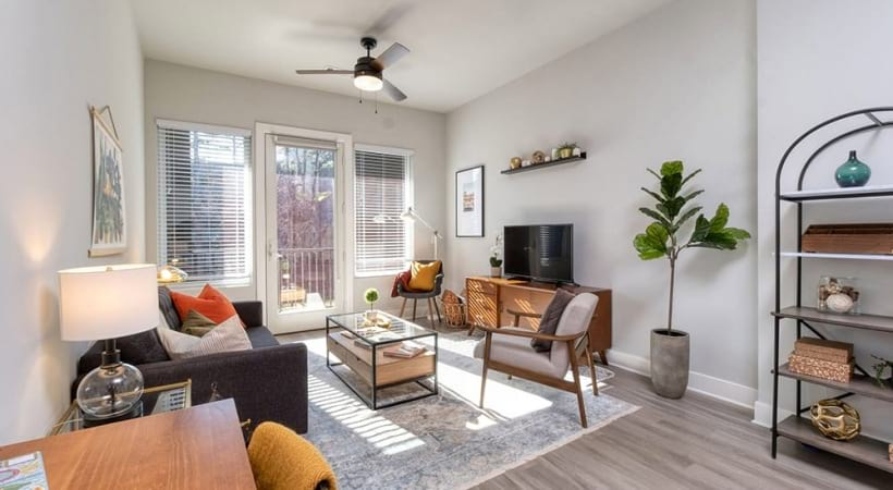 Spacious Living Room With Tall Ceilings At Our Apartments Near Briarcliff Road