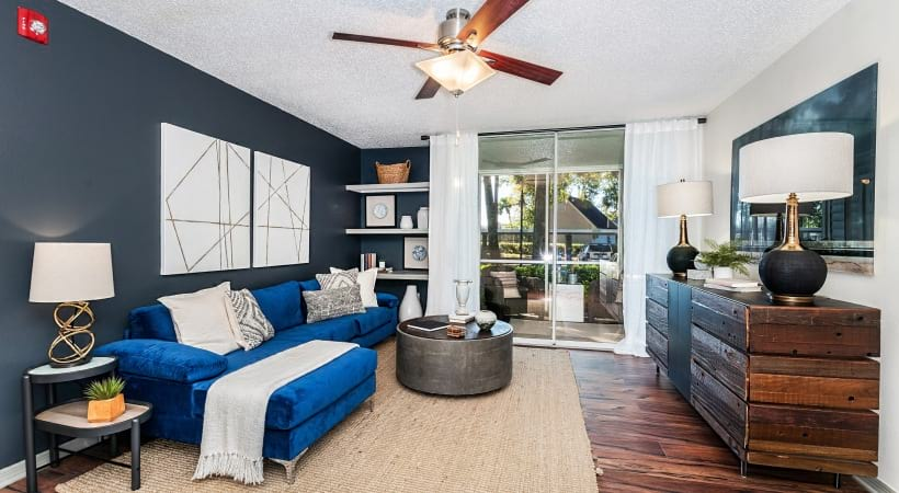 Living room with ceiling fan in our luxury apartments for rent in Casselberry, FL